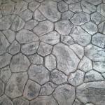 pavimento grigio in porfido stampato