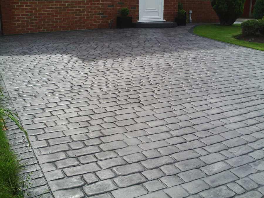 Foto cemento stampato pavimento moderno for Zoccolo esterno