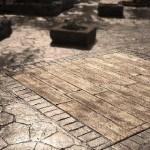pavimento in cemento stampato effetto legno e porfido