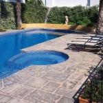 pavimentazione in cemento stampato piscina