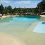 piscina effetto spiaggia di mare