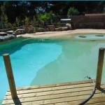 piscina laghetto effetto spiaggia