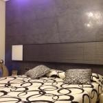 microcemento antipolvere per parete letto